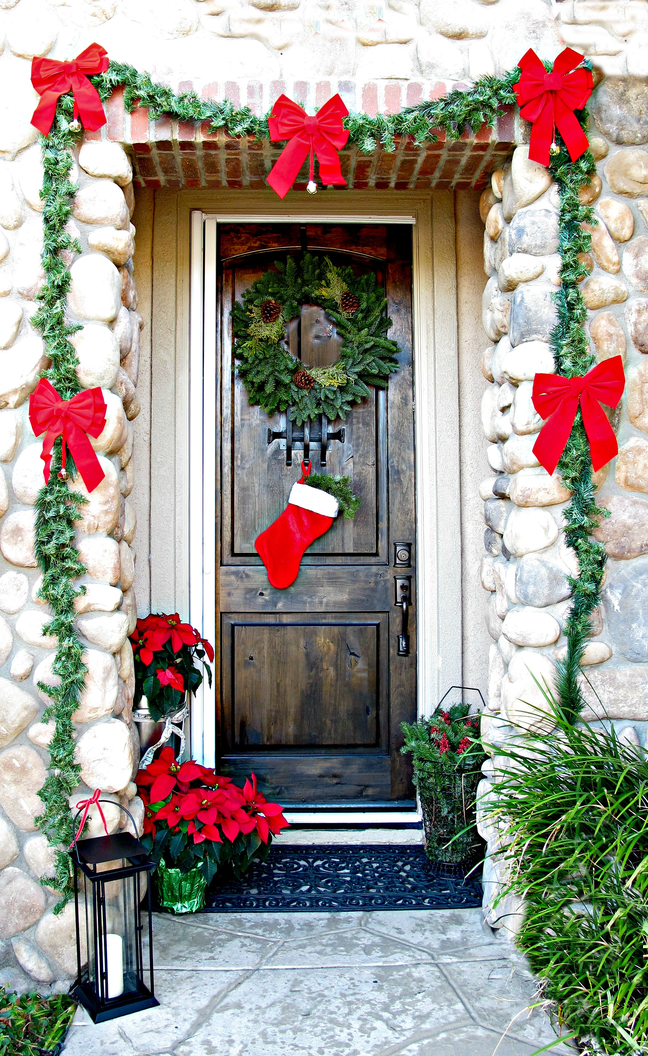 01 gift wrapped with garland christmas door decor - Front Door Christmas Decorations Ideas
