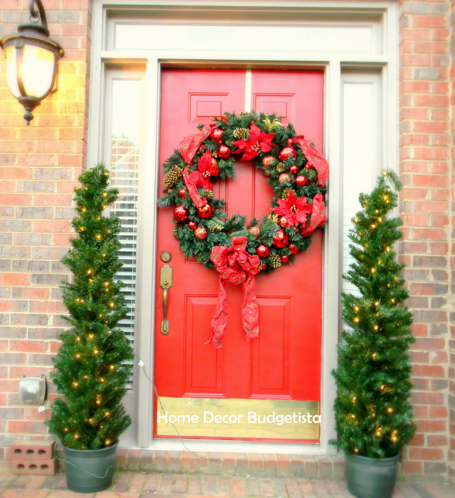 a jumbo wreath with jolly decorations - Best Christmas Door Decorations