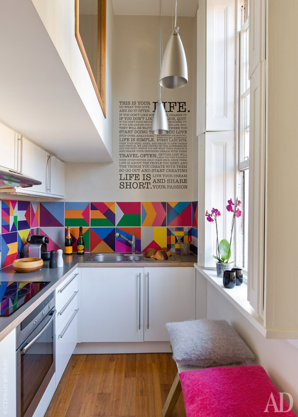a very narrow space becomes larger than life with bright hues - Narrow Kitchen Design Ideas