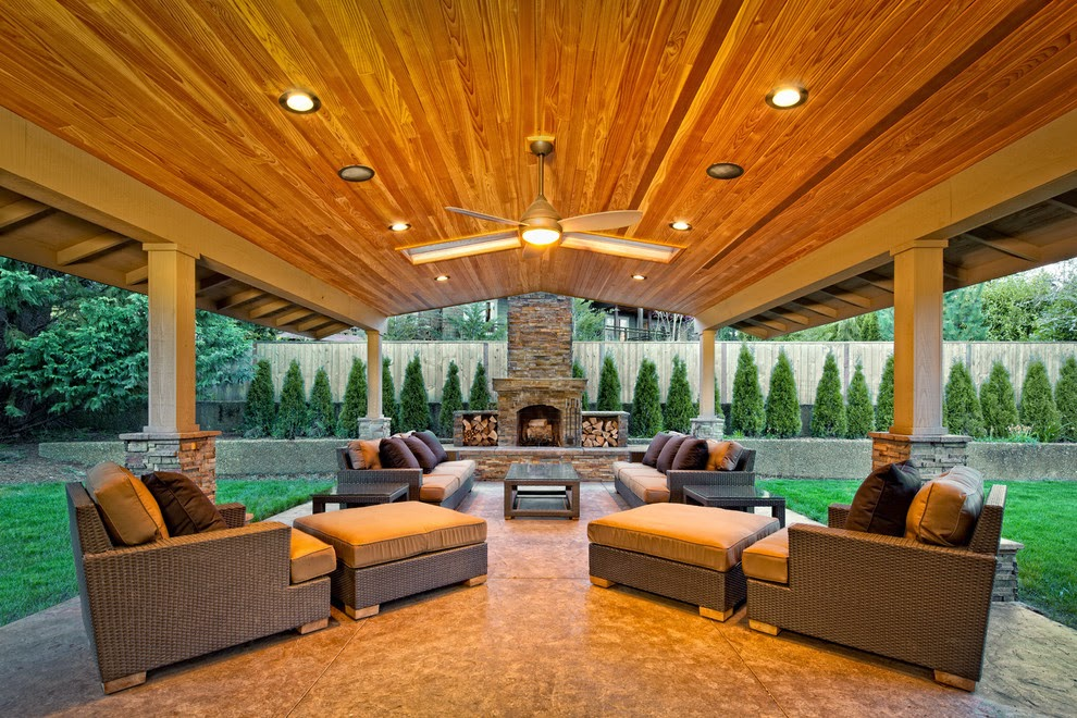 50 best patio ideas for design inspiration for 2017 for Back to back indoor outdoor fireplace