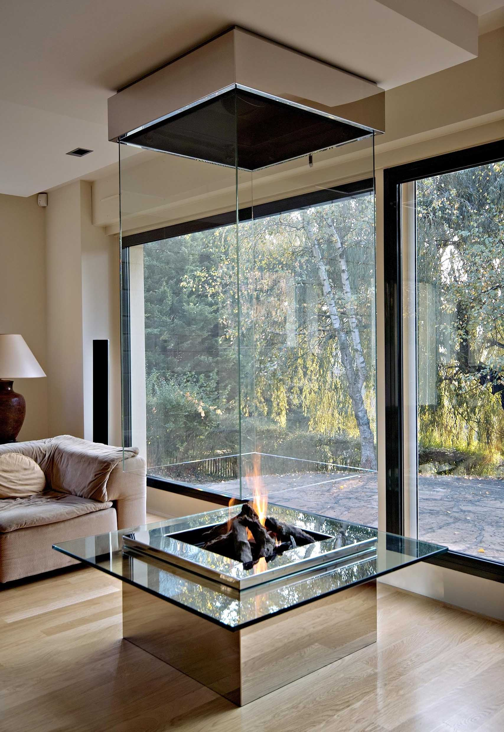 mirrored glass fireplace idea - Modern Fireplace Design Ideas