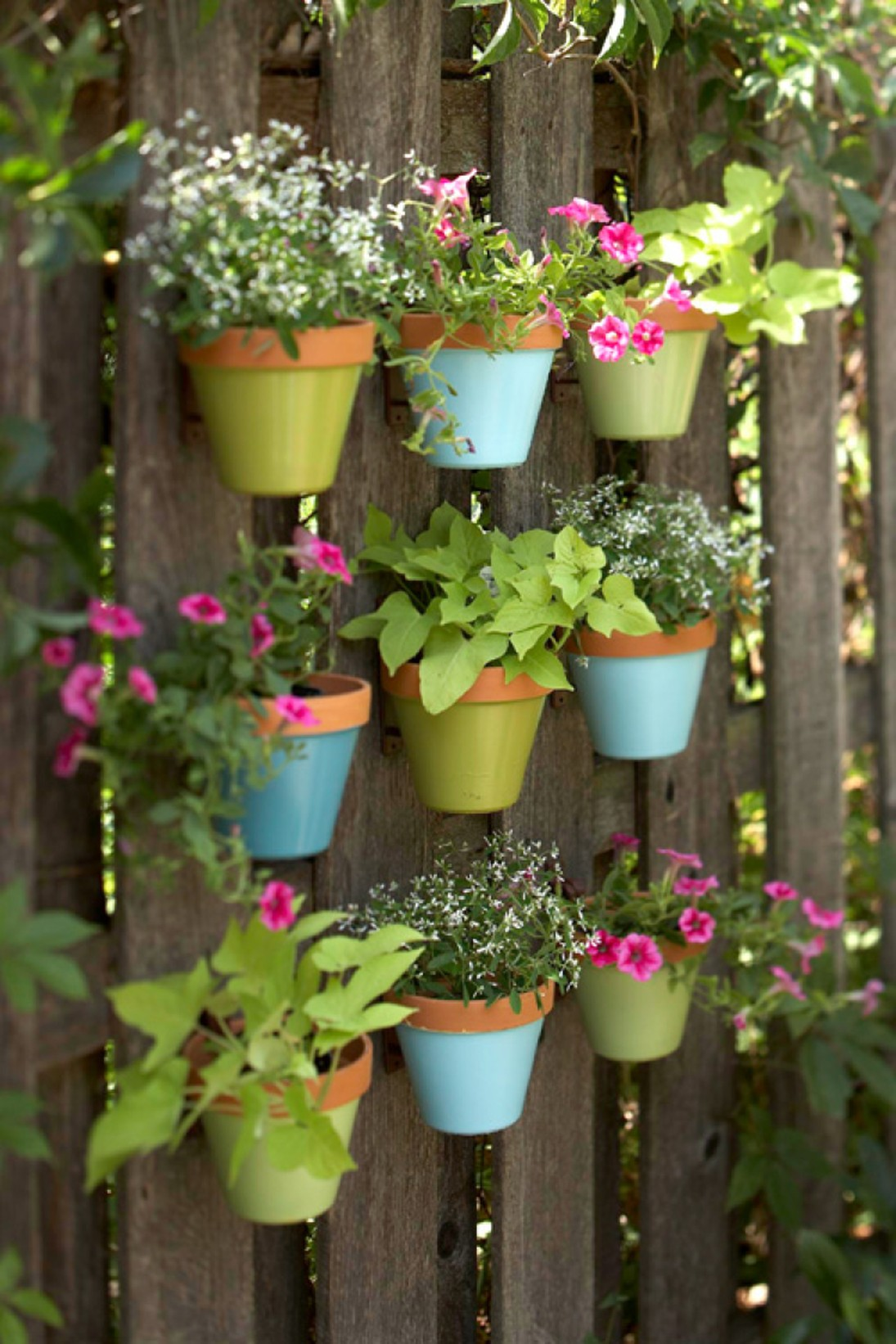 Vertical Gardening Ideas stackable vertical gardens can be any design or material just use your imagination 7 Pastel Shades Of Blue And Green Highlight This Charming Design