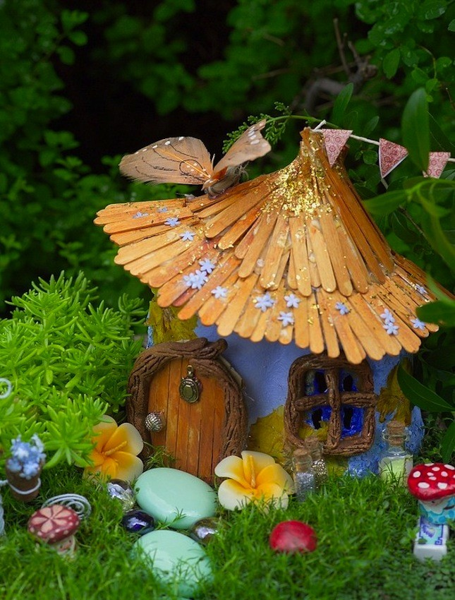 20. Popsicle Stick Roof Cottage