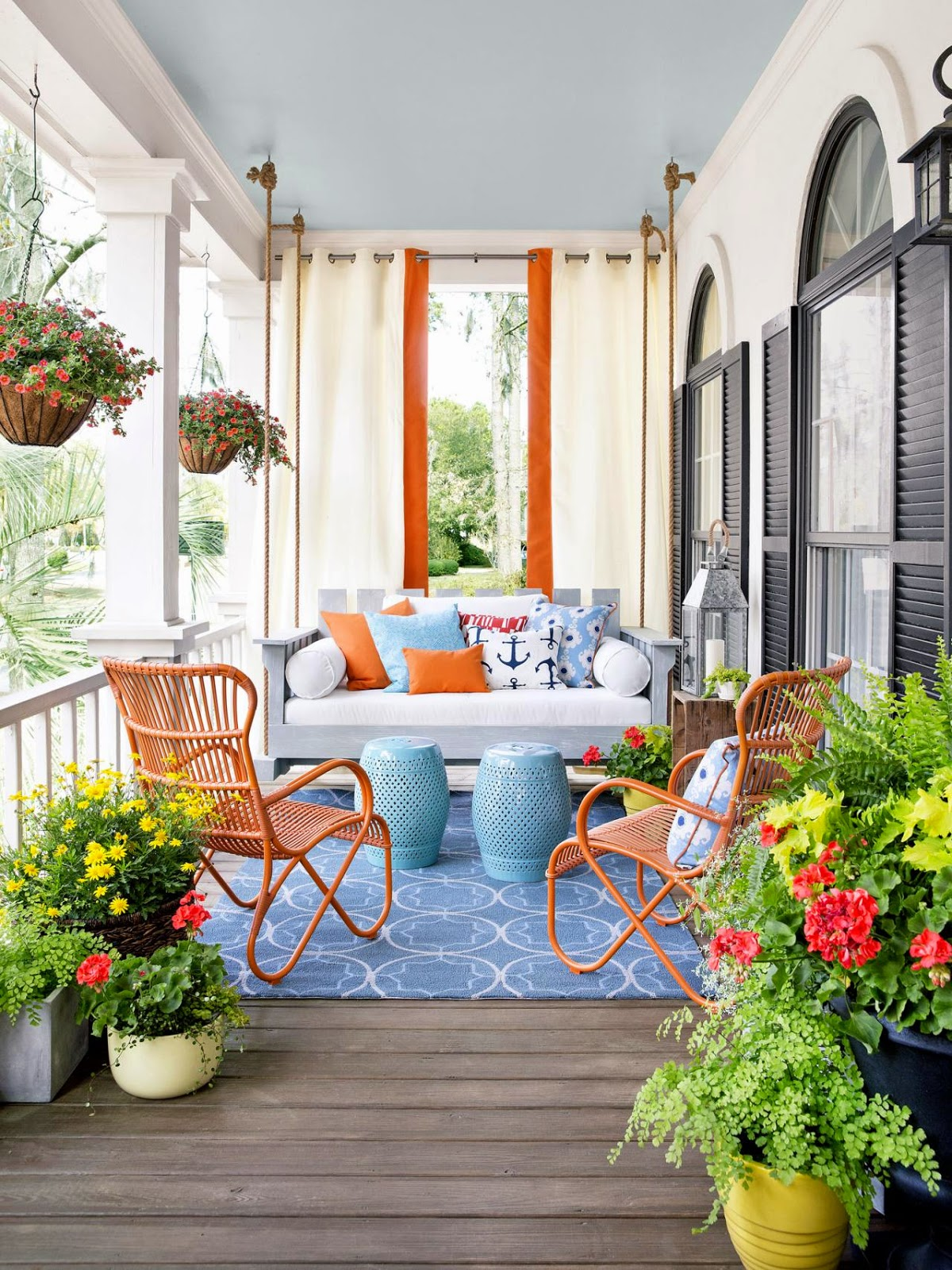This Setting Combines Potted Plants With Rustic Furnishings To Create An Outdoor Living Room