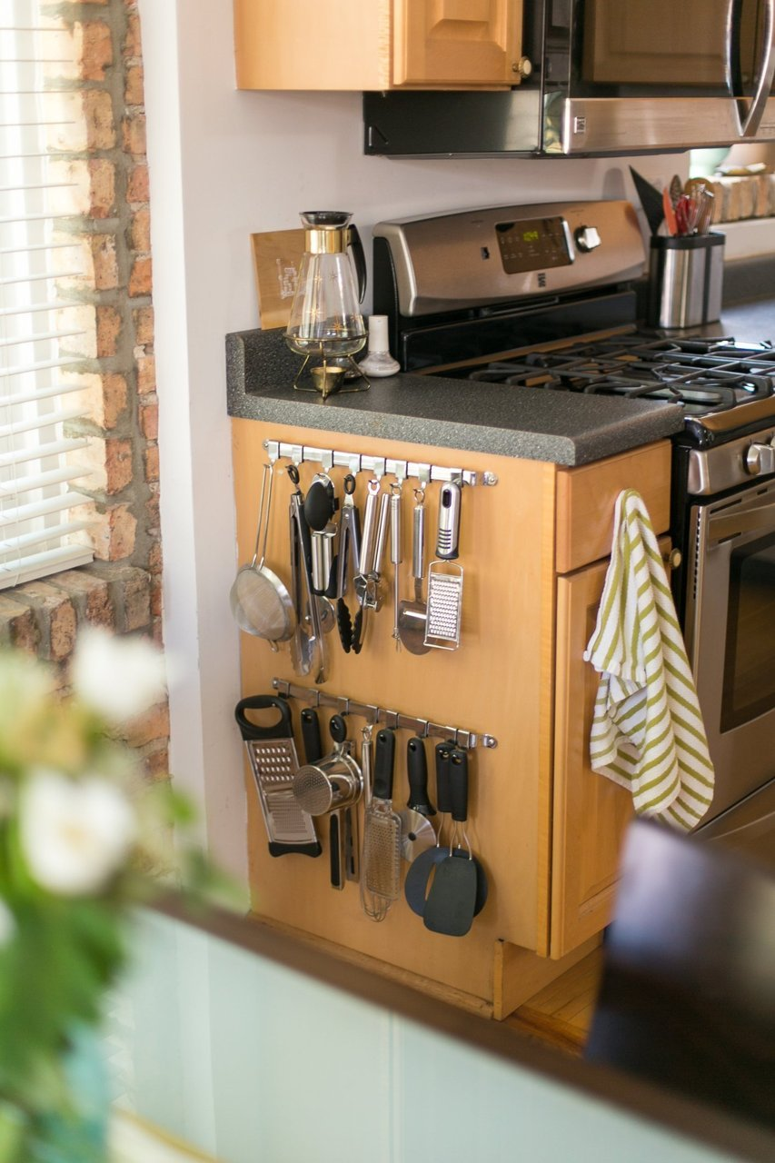 Attach Rack With Hooks to Outside of Cabinets For Utensils