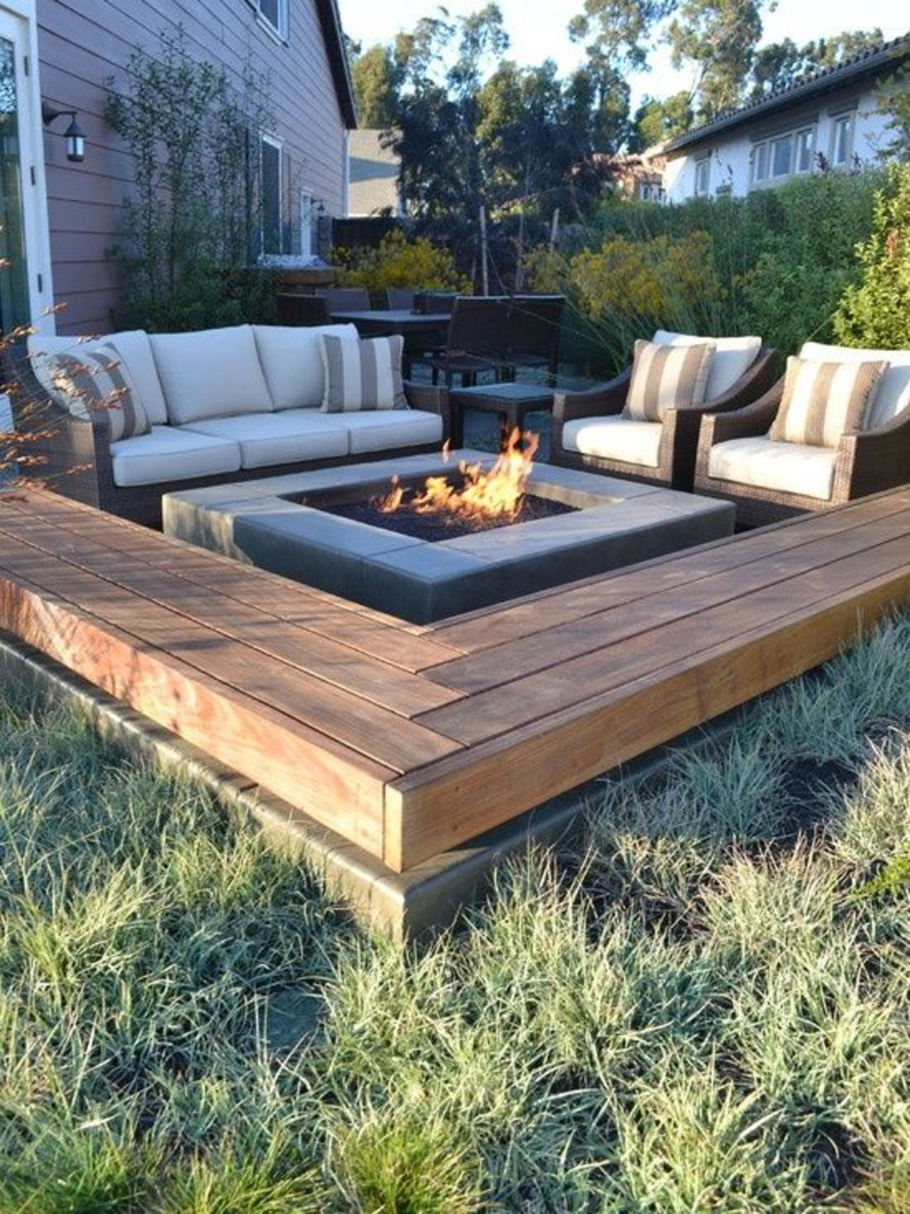 25 best diy patio decoration ideas and designs for 2018 centered fire pit with sofa and matching armchairs diy solutioingenieria