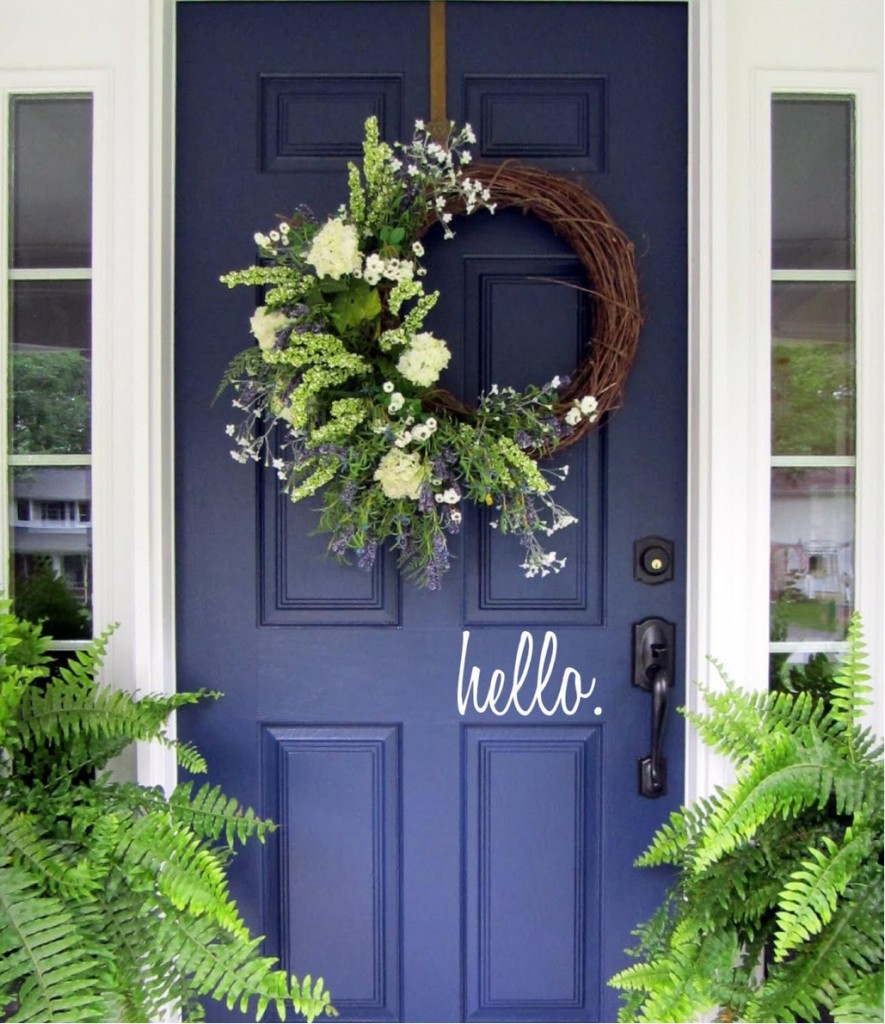 A Dark Blue Door Provides a Wonderful Contrast to a Green Planter