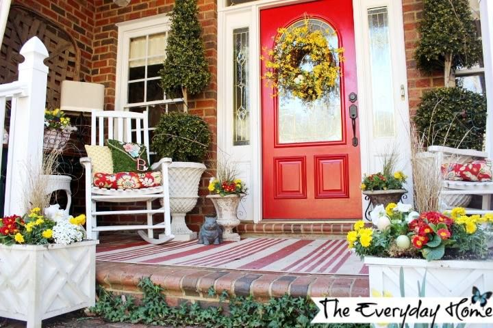 White Planters and a Wood Rocker Let the Red Door Pop