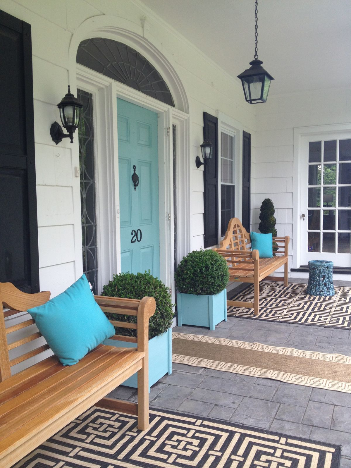 Blue Pillows Perfectly Coordinate With a Cool Blue Door