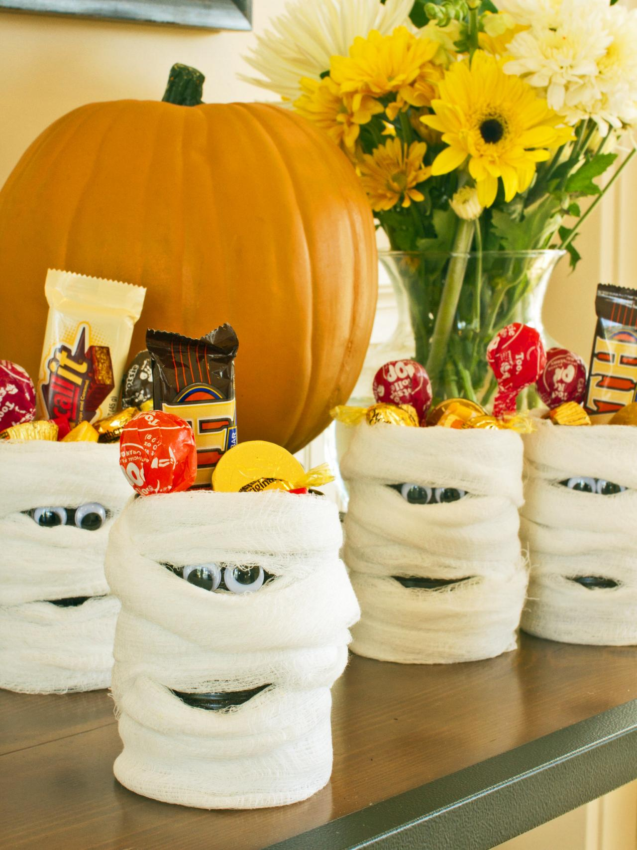 Halloween party decoration ideas diy - 1 Mummy Candy Cans For Take Home Treats