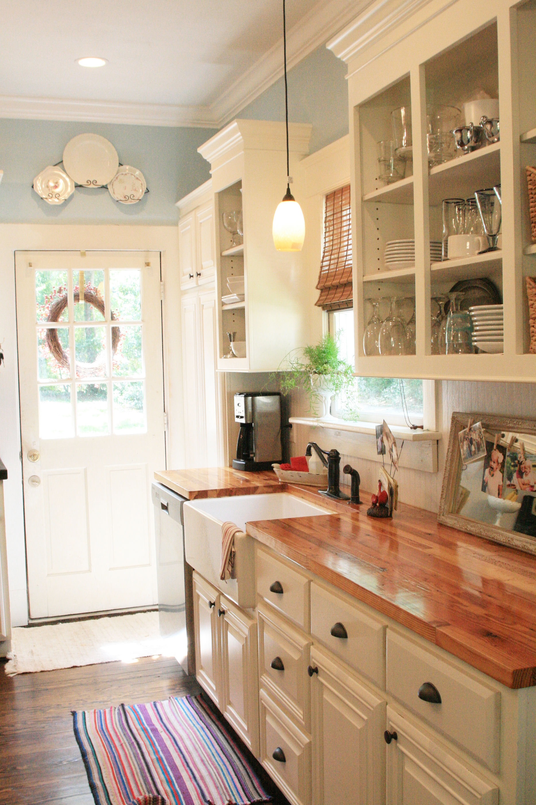wood counters add warmth to a clean white kitchen - Country Kitchen Ideas