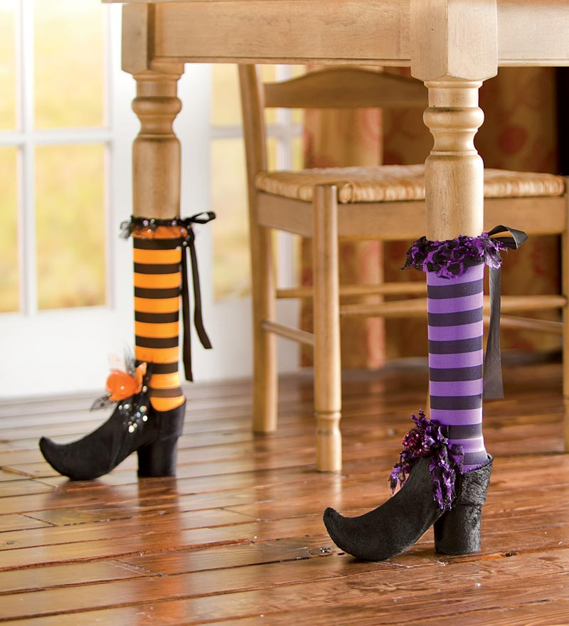 11 bewitch your dining room with table leg covers - Unique Halloween Decorations