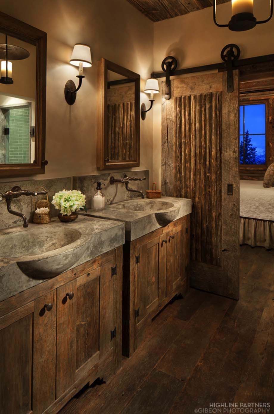 rustic bathroom dcor with concrete sinks and barn door