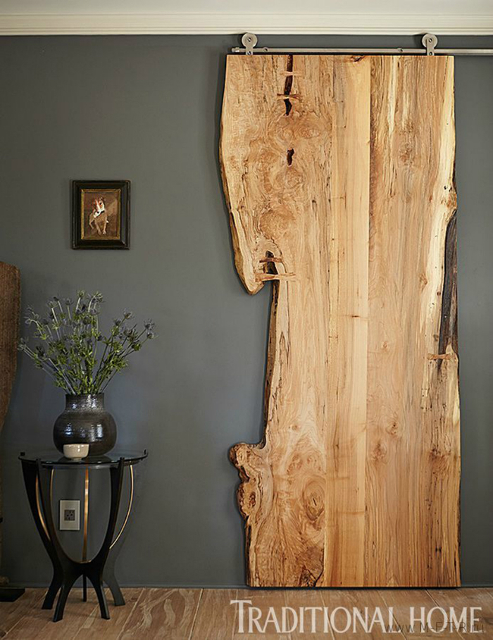 Woodsy Room Divider That Resembles A Sliding Door