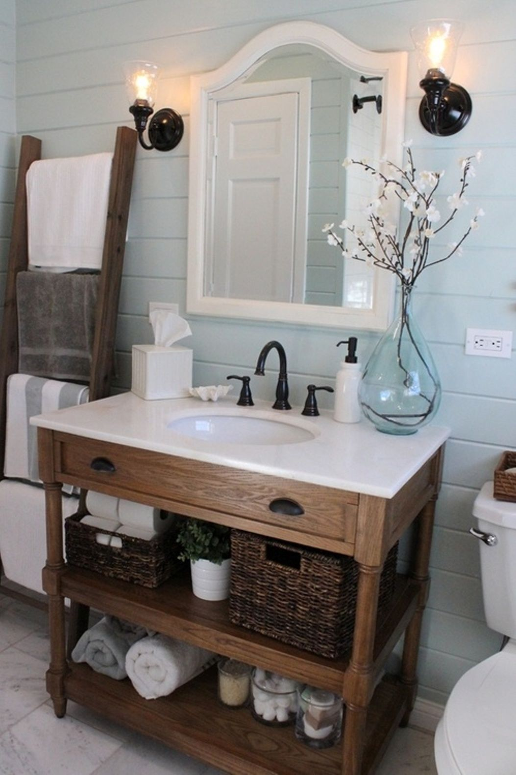 Rustic bathroom decor - Cottage Bath With Painted Shiplap And Vintage Hardware
