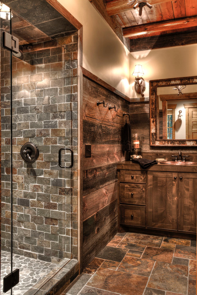 stone lodge bathroom featuring a camo edged mirror - Bathroom Ideas Rustic