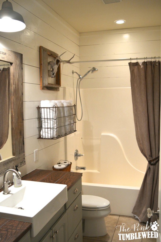 hunters bathroom featuring shiplap and hunting trophy - Rustic Bathroom
