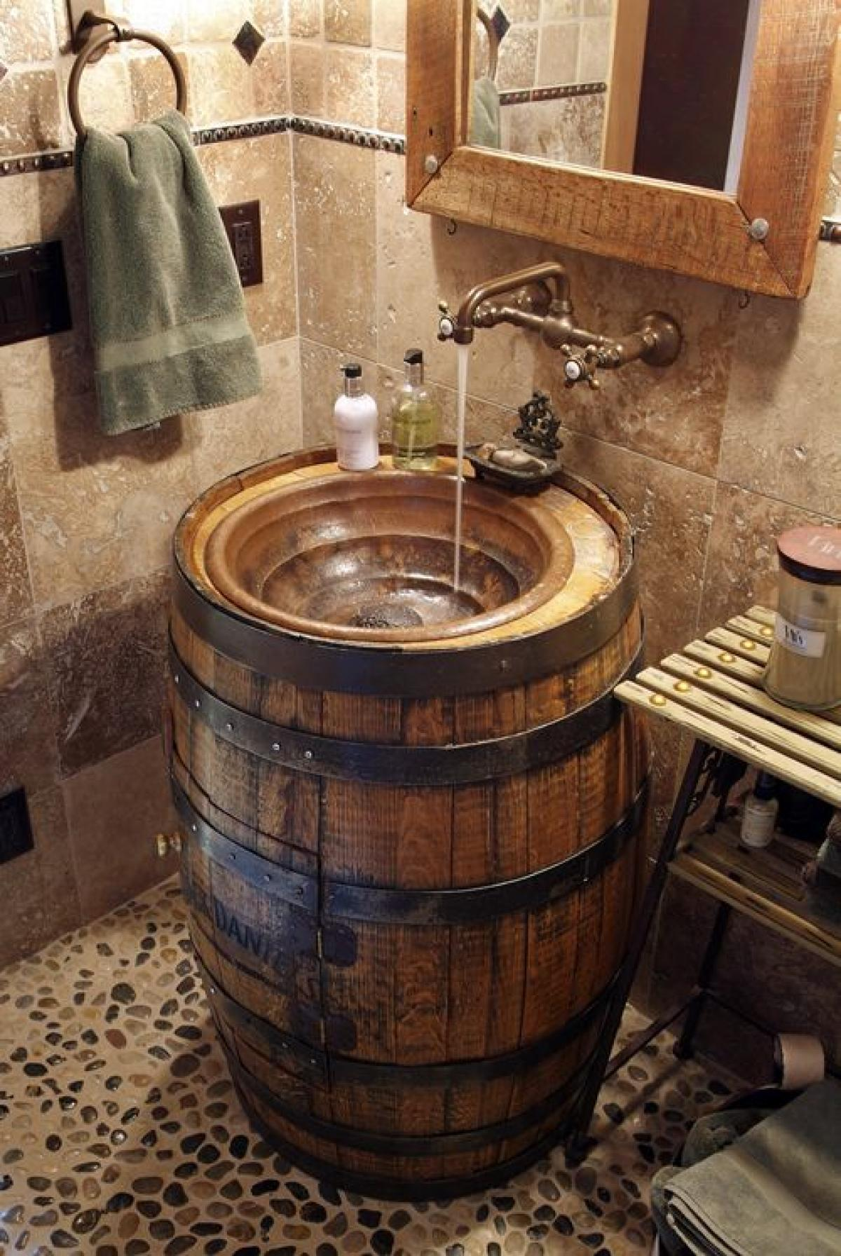 Rustic bathroom decor - 12 Converted Whiskey Barrel Sink