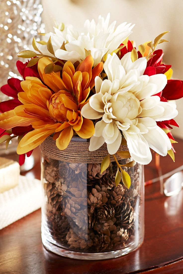 14 Fall Blooms In A Pinecone Filled Vase