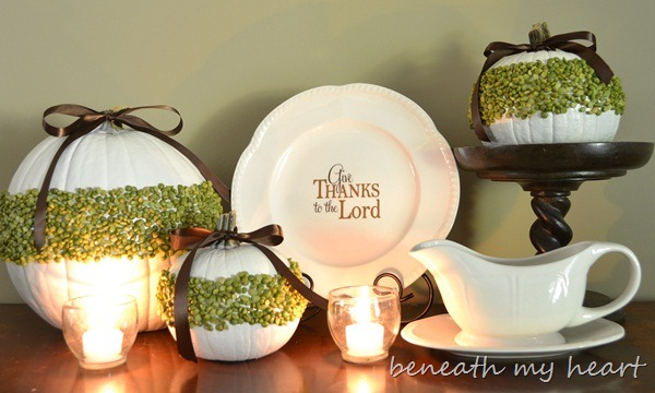 White Pumpkins with Moss Accents, White Accessories, and Candle