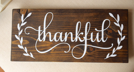 "Wooden Sign with Handwritten ""Thankful"" in White Paint"