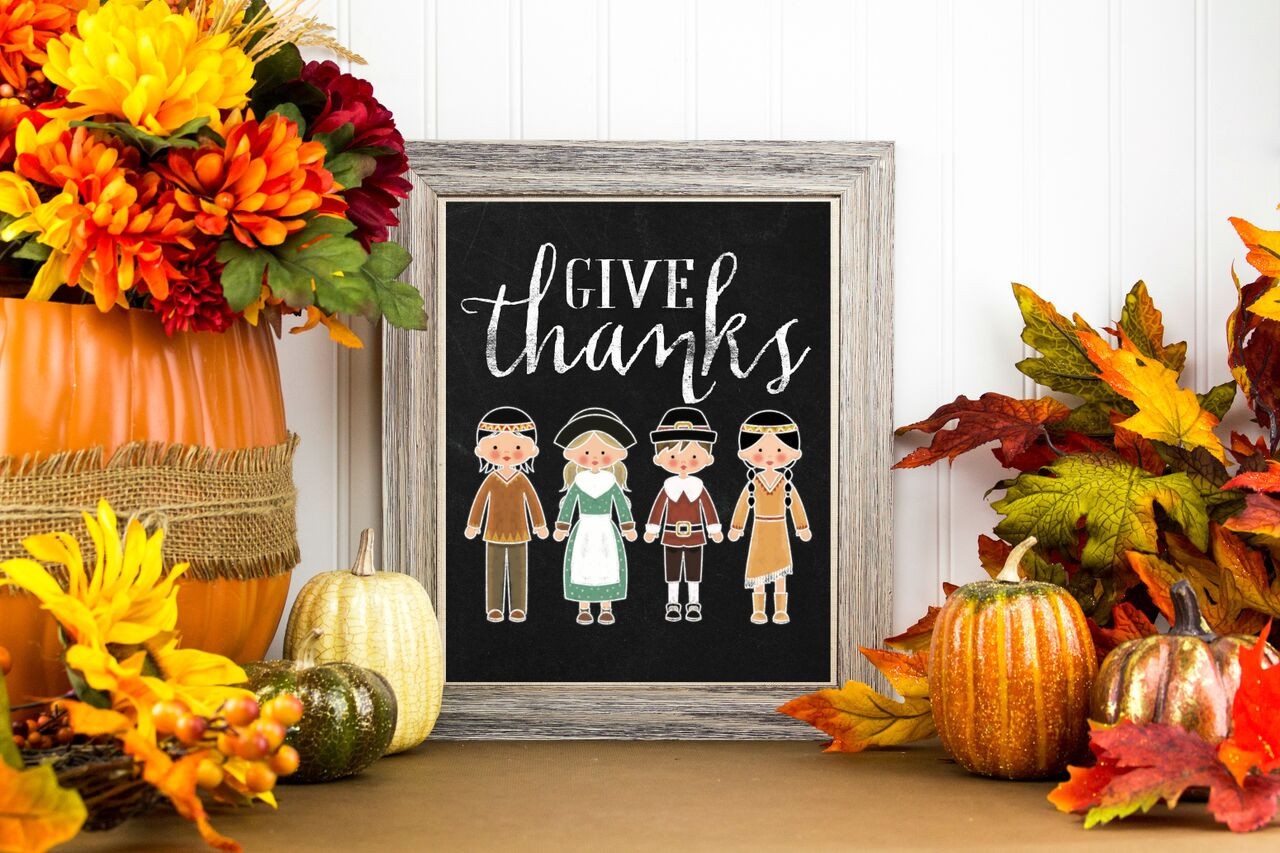 Thanksgiving Figures on Chalkboard with Pumpkins and Fall Foliage