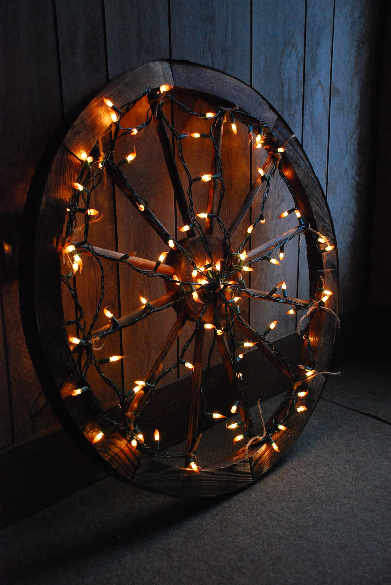 Wooden Spinning Wheel Wrapped in Lights