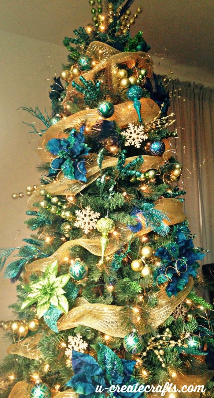 11 pretty peacock - Gold Christmas Tree Decorating Ideas