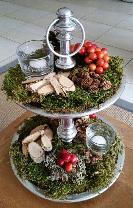 Earthy Votive Display With Berries And Pinecones