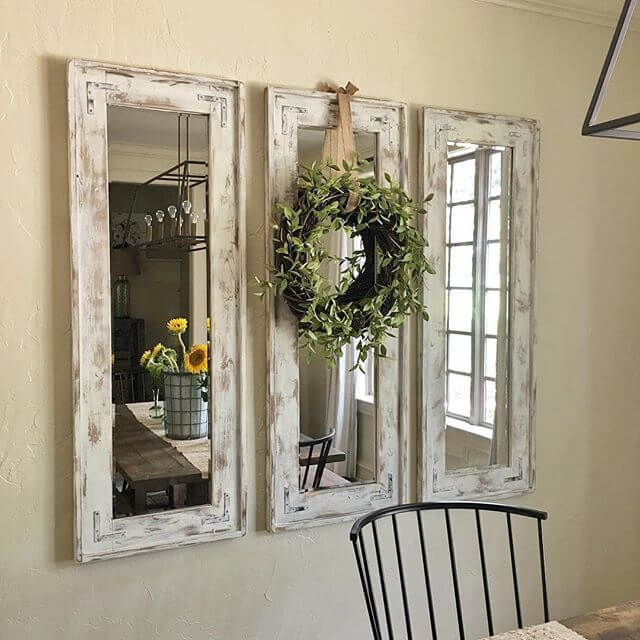 5 triad of narrow whitewashed mirrors accented with eucalyptus wreath farmhouse interior design - Farmhouse Interior Design Ideas