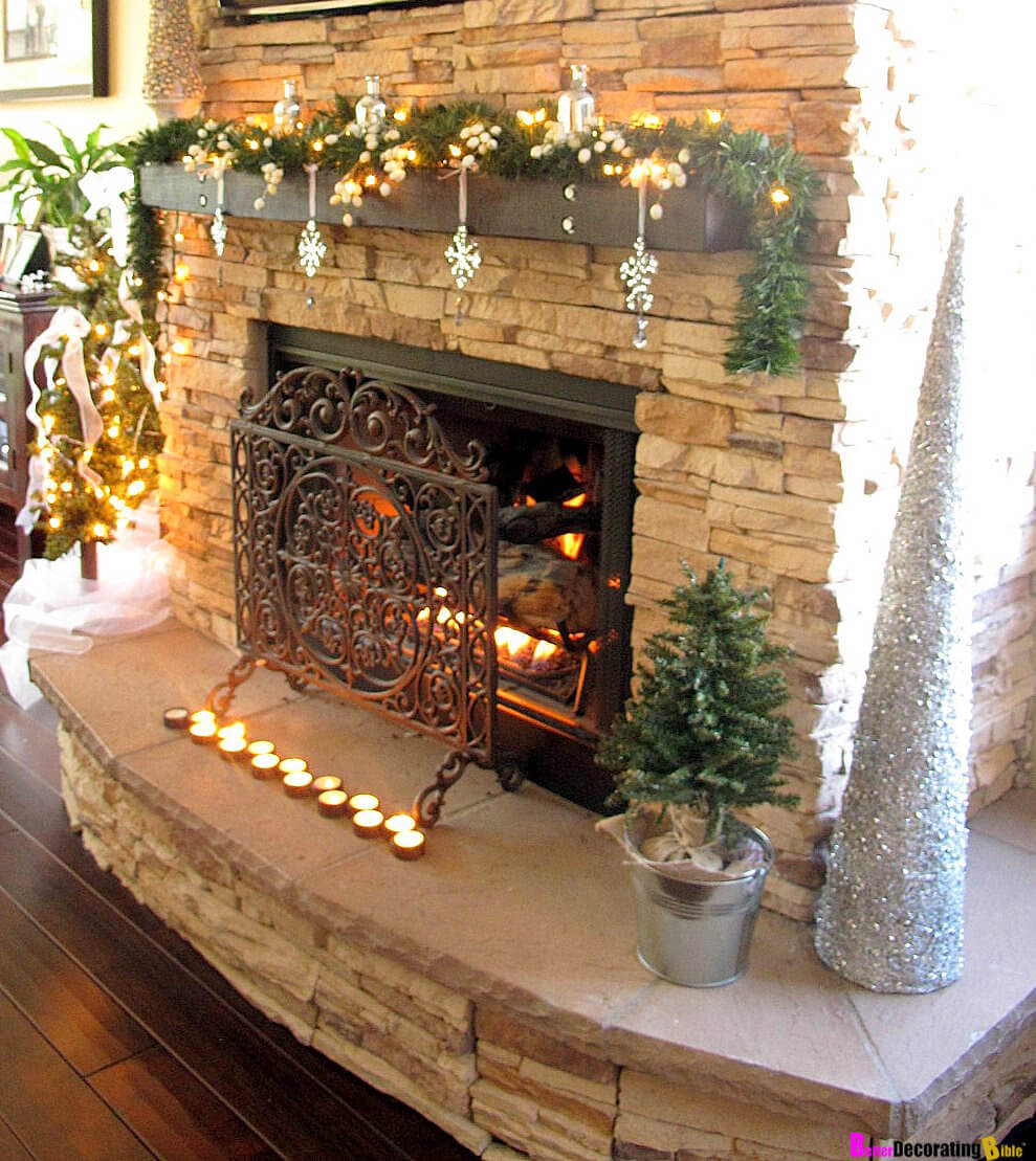 31 add visual interest with dangling ornaments - Christmas Mantel Decorating Ideas