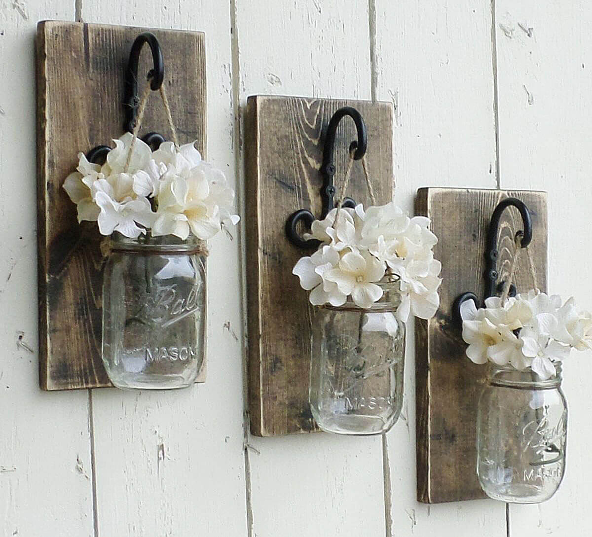 3 hanging mason jars filled with flowers