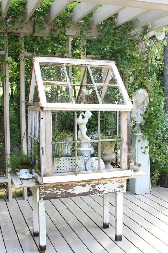 One Of The Repurposed Old Window Ideas Is A Terrarium