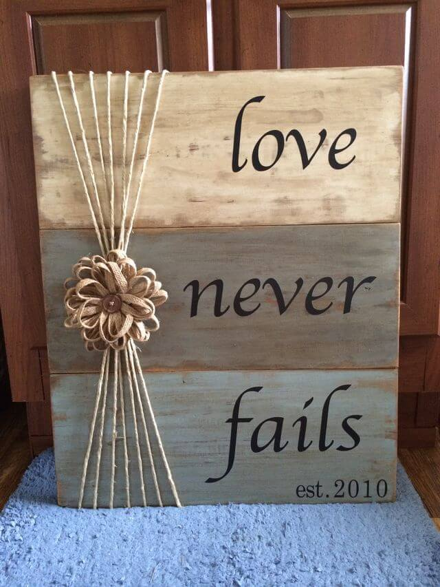 """Love Never Fails"" Tri-Color Weathered Wood Sign"