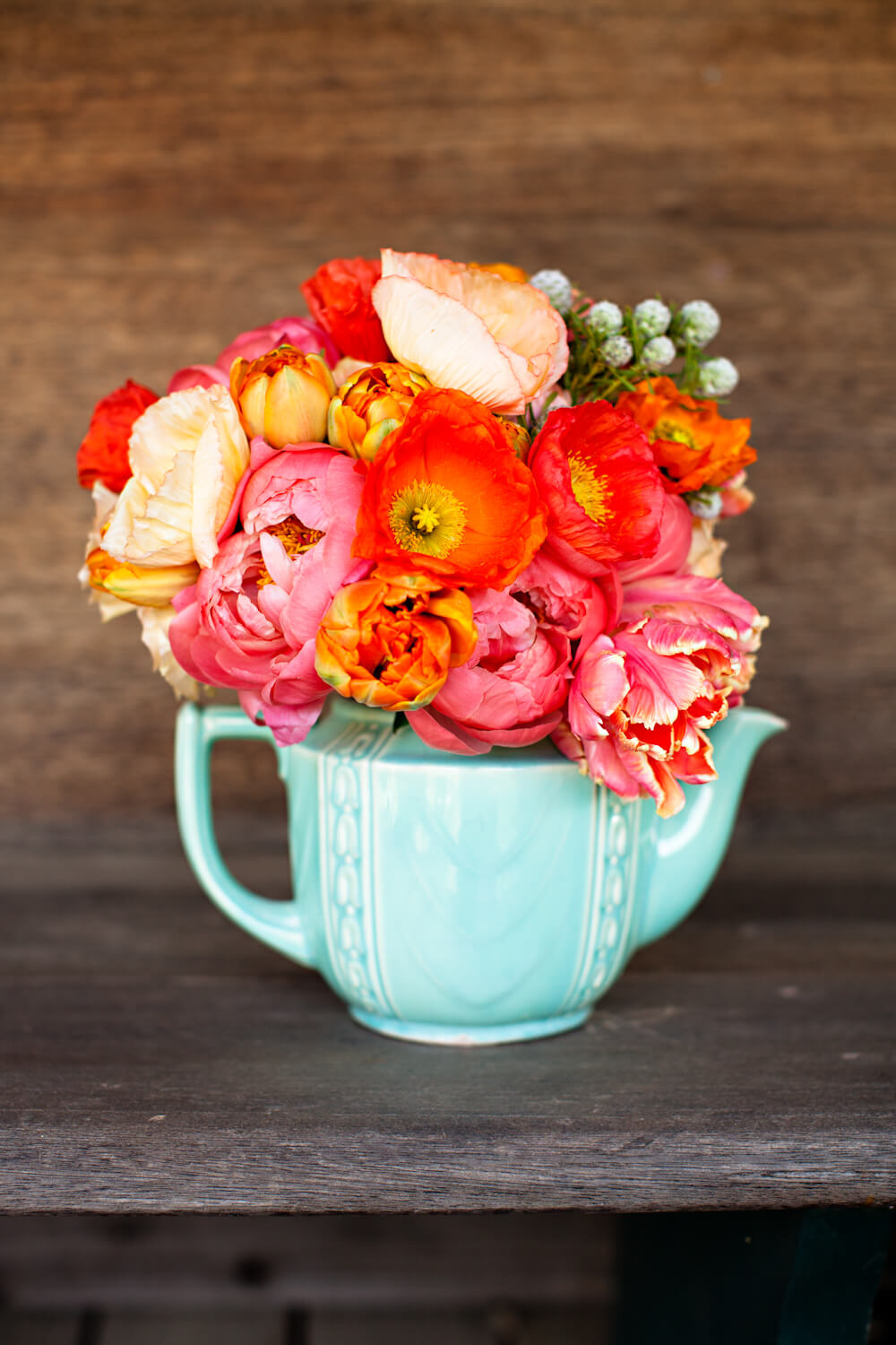 Cool Mint Teapot Bursting with Fiery Blossoms