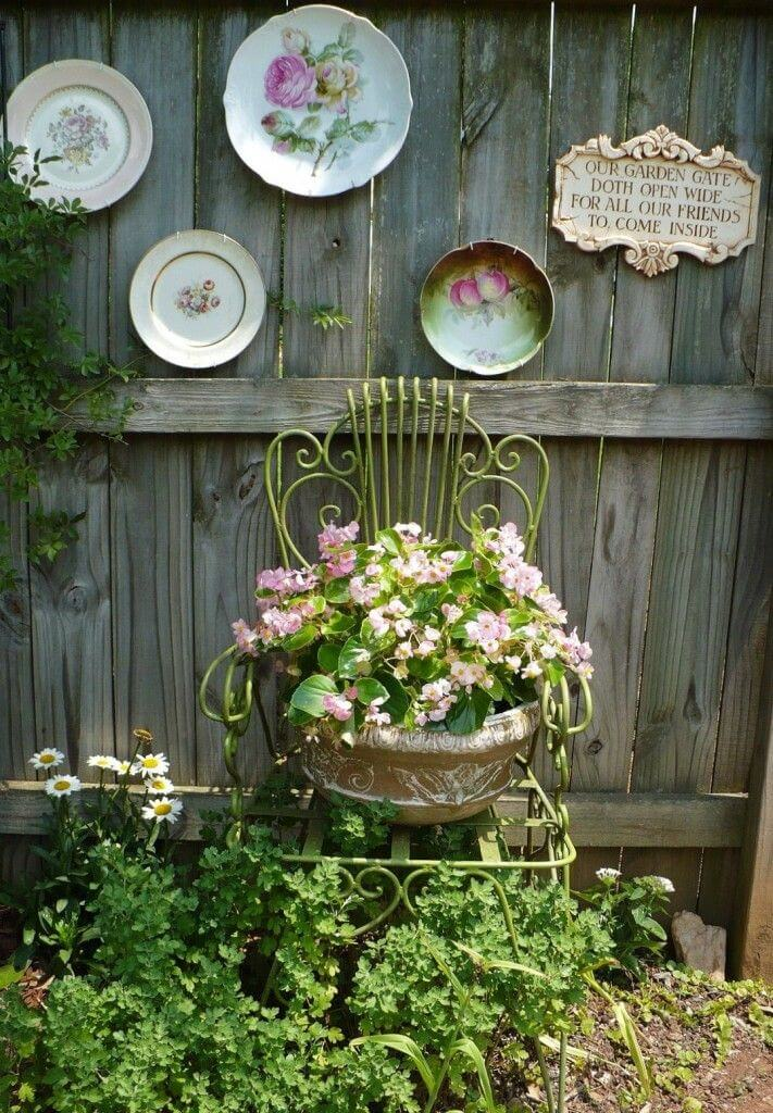 1. Antique Chair Planter Plus Vintage Plates