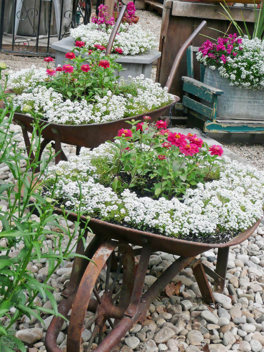 2. Rusty Vintage Wheelbarrow Flower Planters
