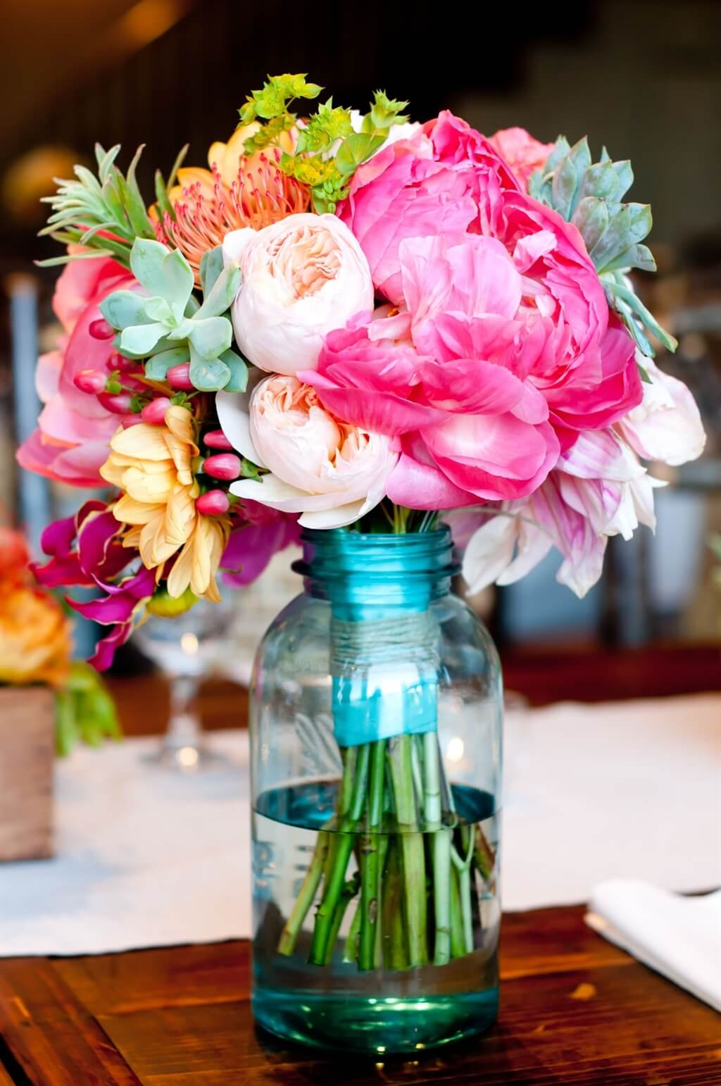 Bridesmaid's Bouquet Resting in Mason Jar