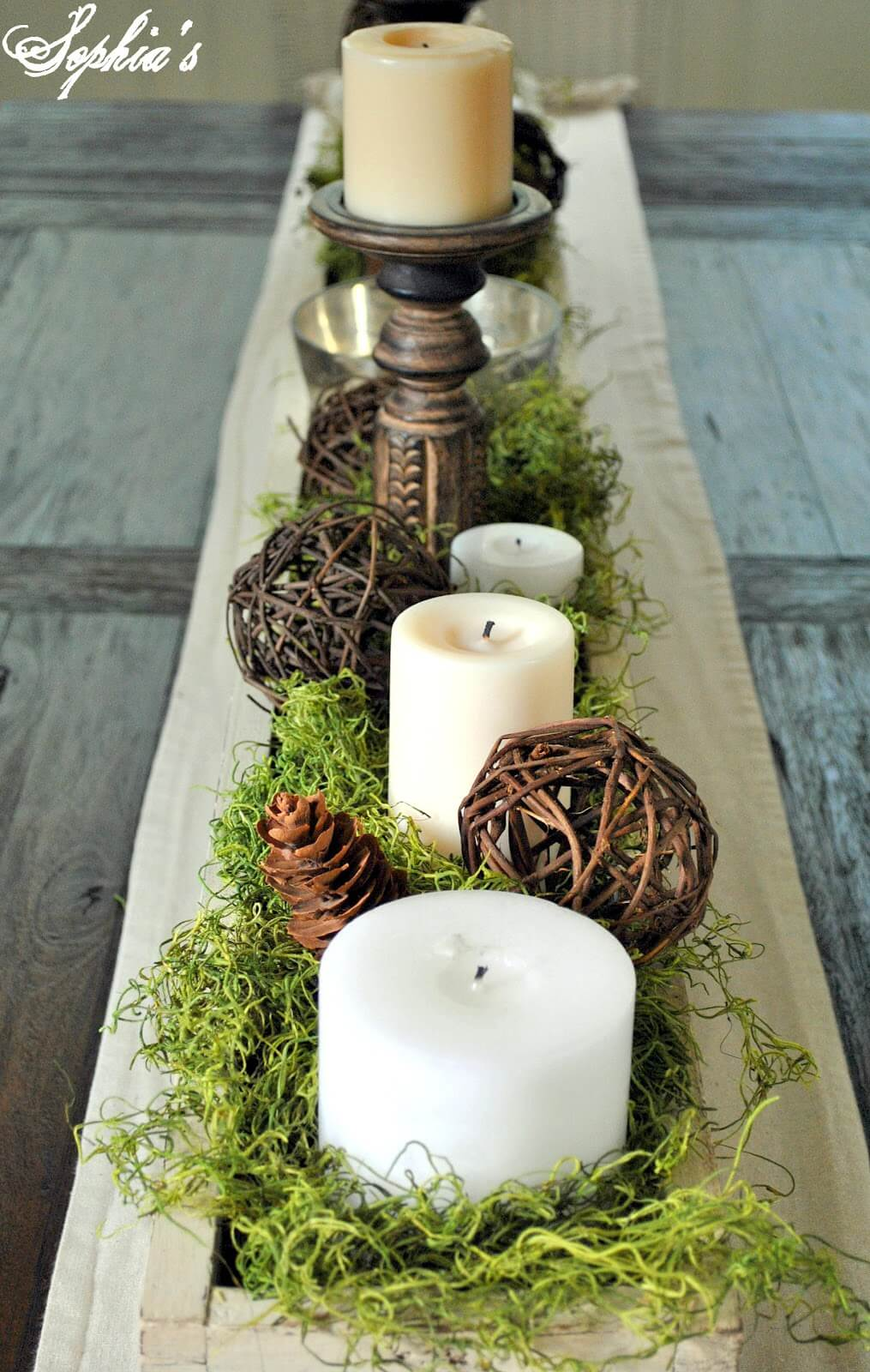 An Earthy Display with Fake Grass and Pine Cones