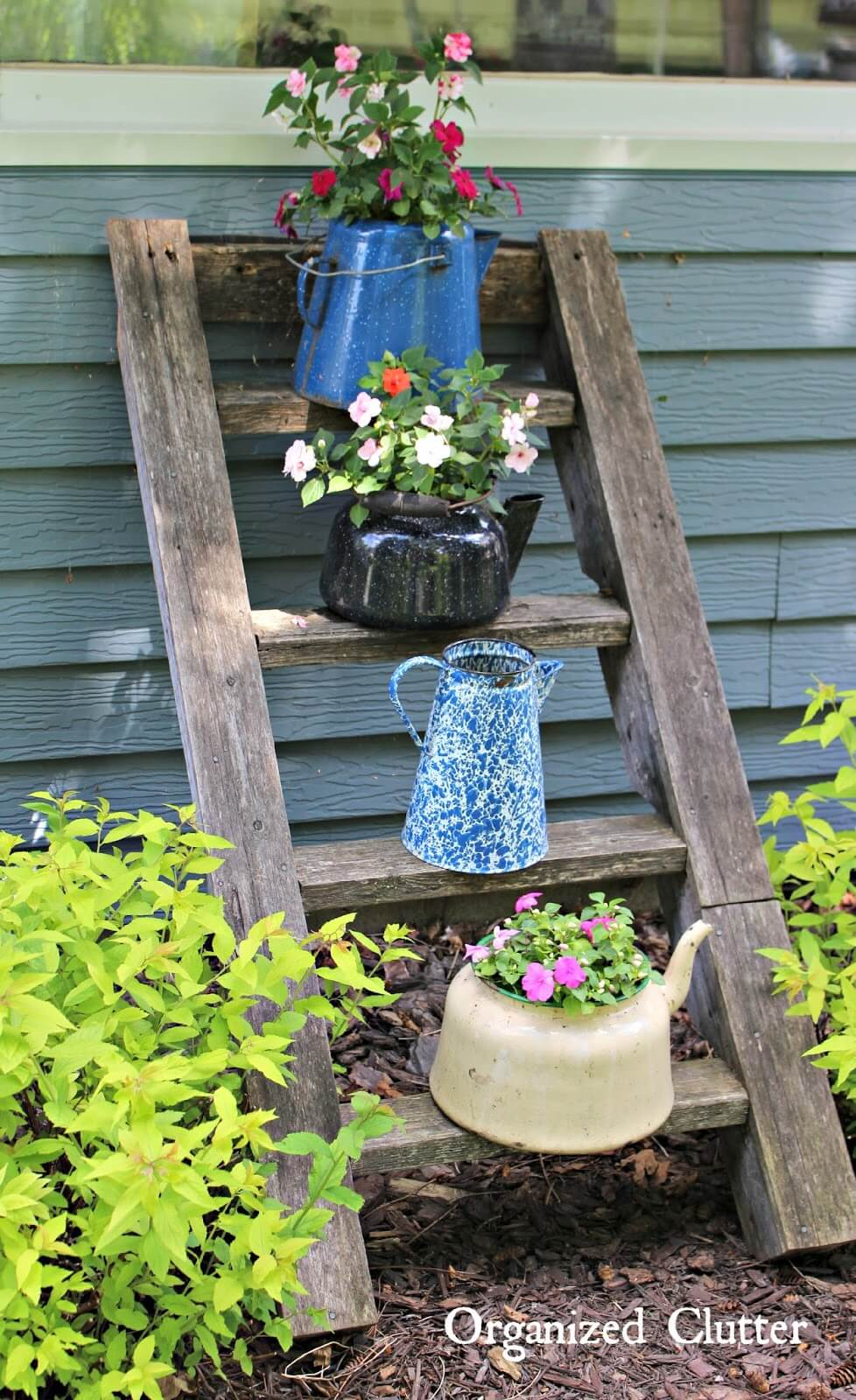 10. Vintage Coffee Pot Planters With Ladder Display