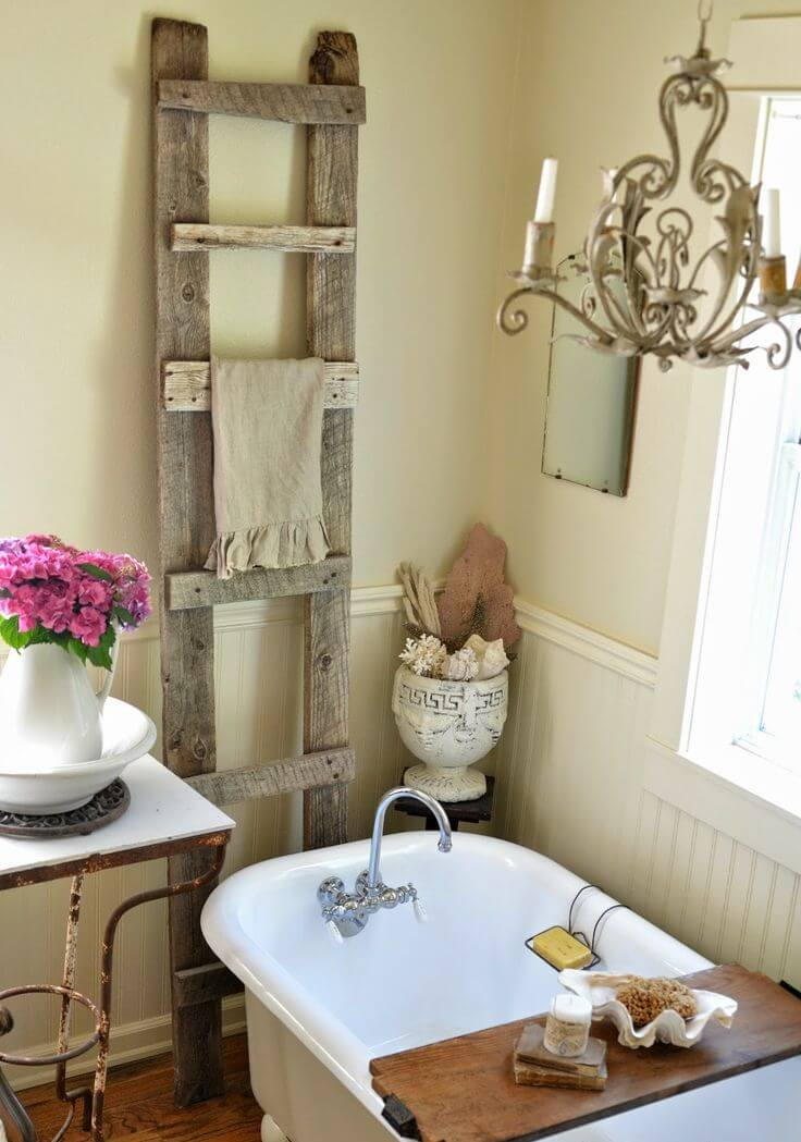 11. Antique Wood Ladder Towel Rack