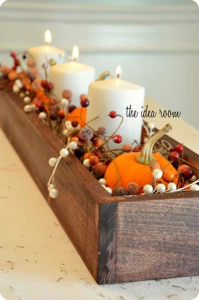 Fall Inspired Centerpiece With Bright Orange Pumpkins