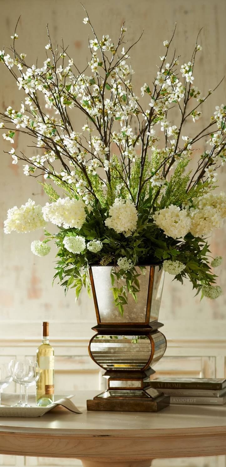 A Glamorous Floral Arrangement with an Artistic Vase