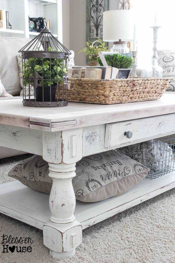 Earthy White-washed Table and Clutter-catching Raffia Basket
