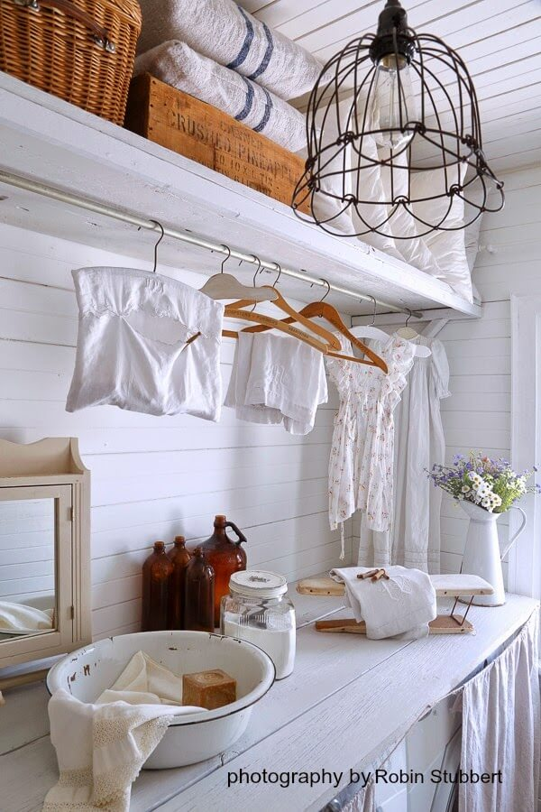 country white laundry room with hanging space - Laundry Room Decor