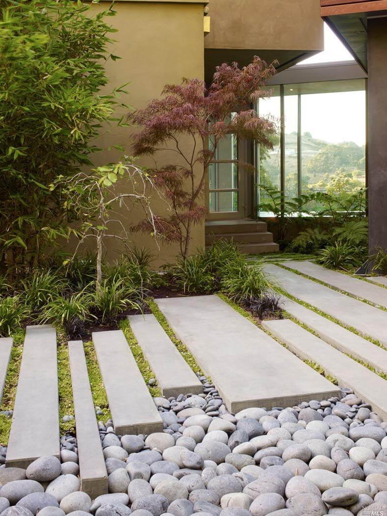 Clean Modern Slabs Contrasted With Natural Stone