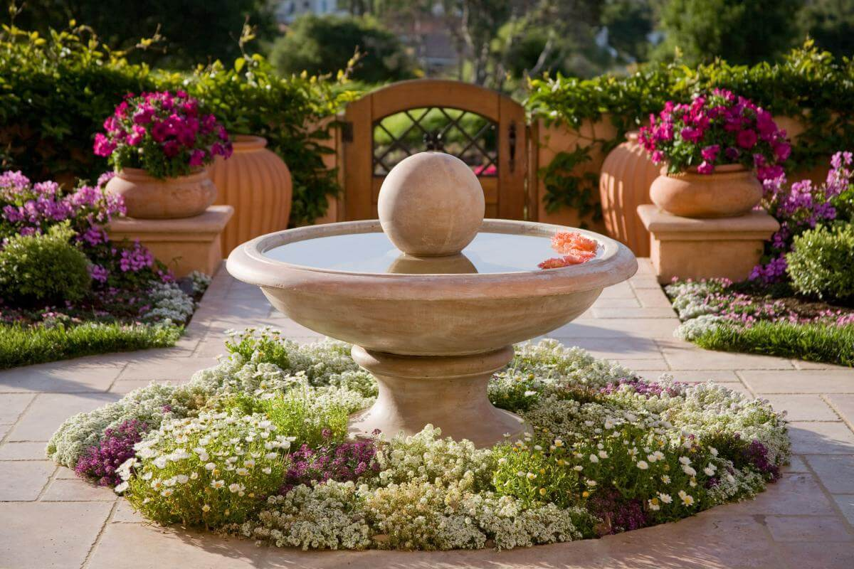 16 elegant mediterranian inspired fountain bed - Low Maintenance Front Garden Ideas