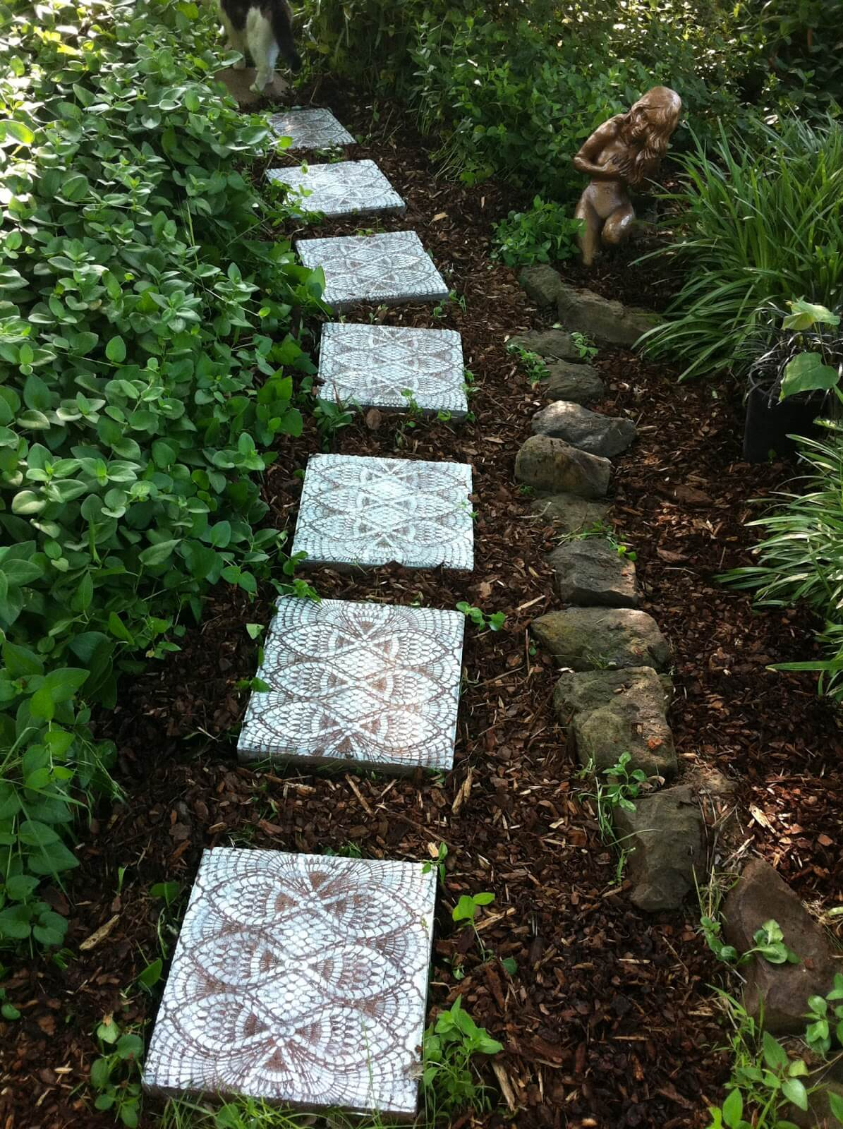 Show Off Custom Tiles Against Dark Mulch
