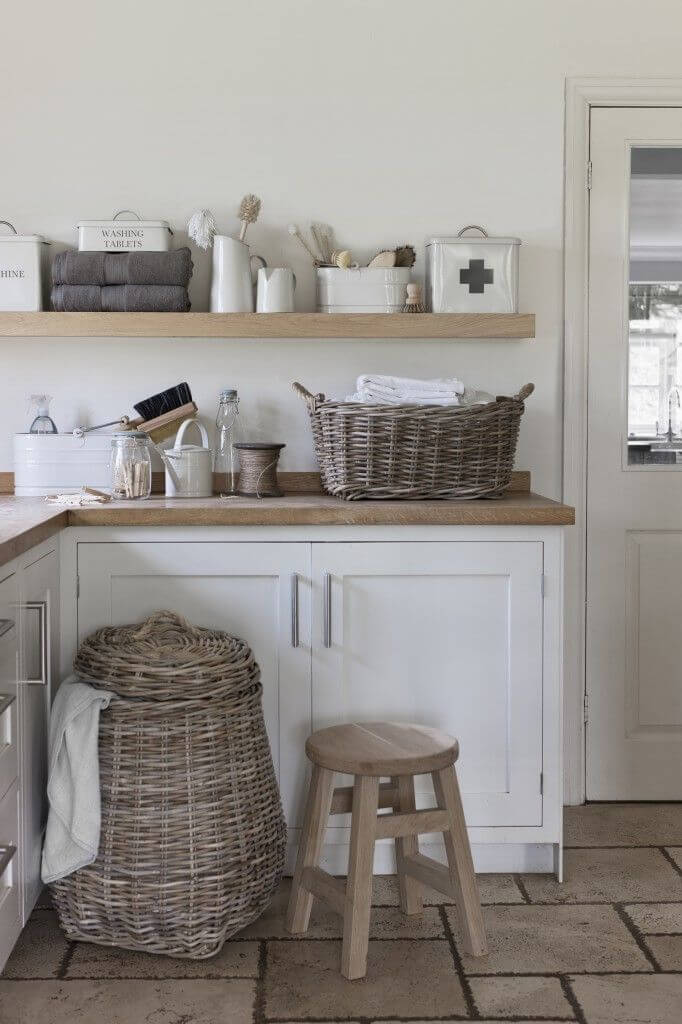 grey and white laundry room with wicker - Laundry Room Decor