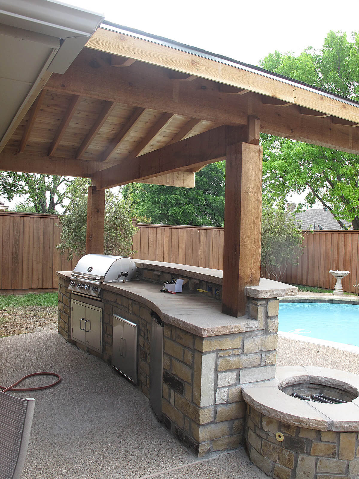 23. Stone Bar With Grill And Fire Pit